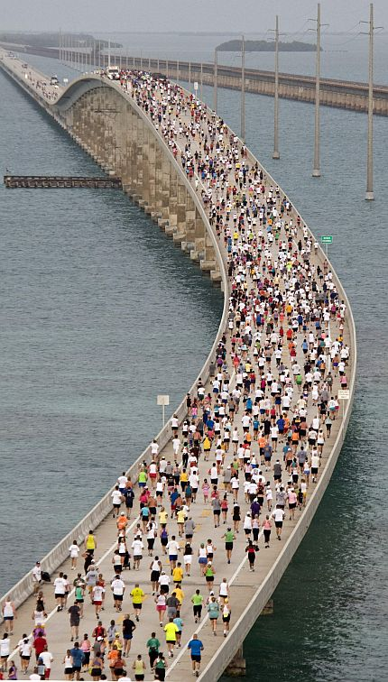 "Some 1,500 runners cross the ""hump"" of the Seven Mile Bridge in the Florida Keys near Marathon Florida"